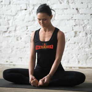 Woman doing yoga wearing tank top | Warrior Grrrls